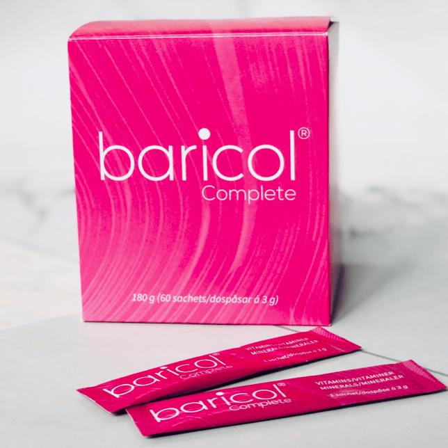 Baricol Complete dospåsar som ligger framför förpackningen